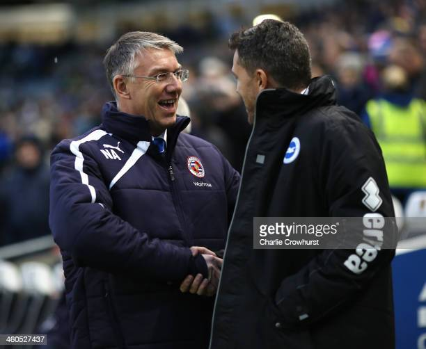 Reading manager Nigel Adkins greets Brighton manager Oscar Garcia during the FA Cup Third Round match between Brighton and Hove Albion and Reading at...