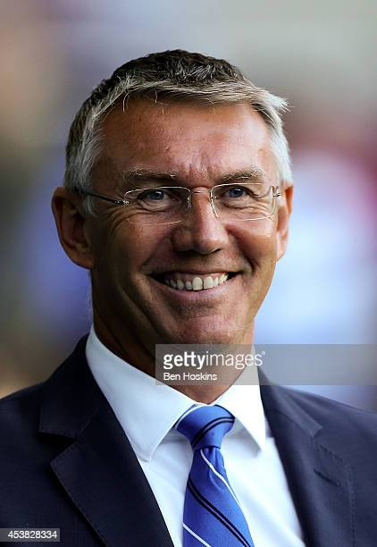 Reading manager Nigel Adkins looks on ahead of the Sky Bet Championship match between Reading and Huddersfield Town at Madejski Stadium on August 19...