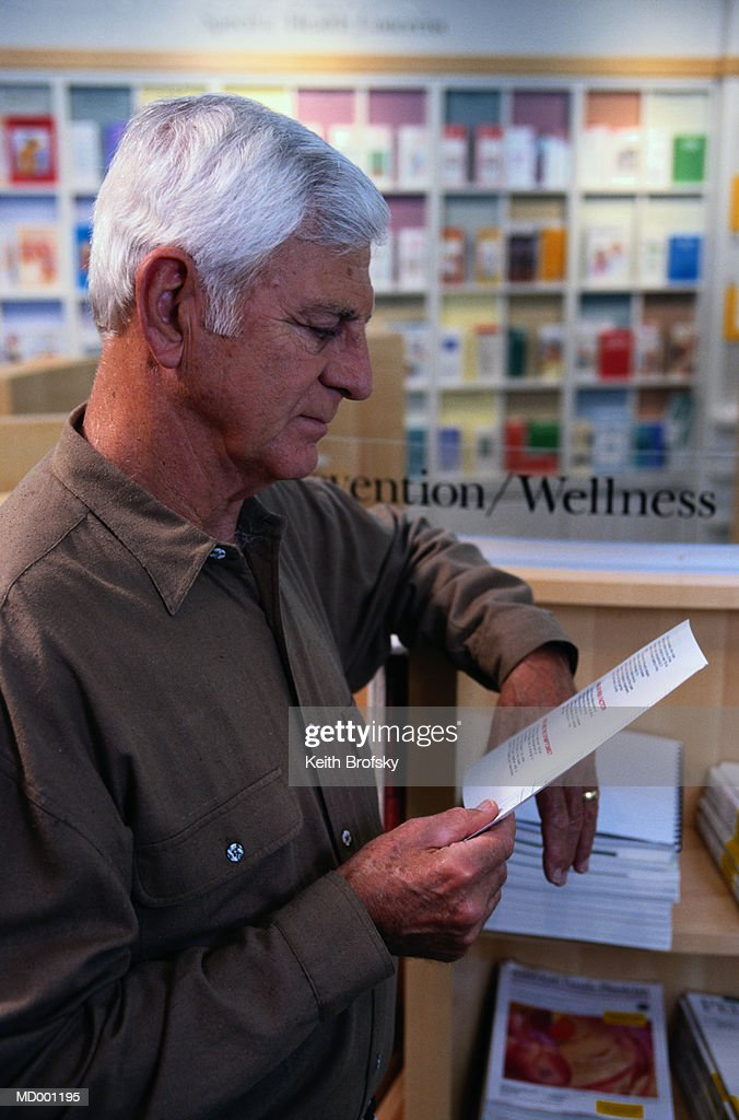 reading medical pamphlet stock photo getty images
