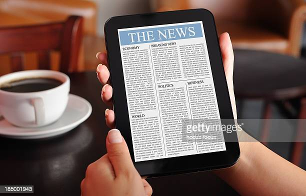 Reading news with digital tablet