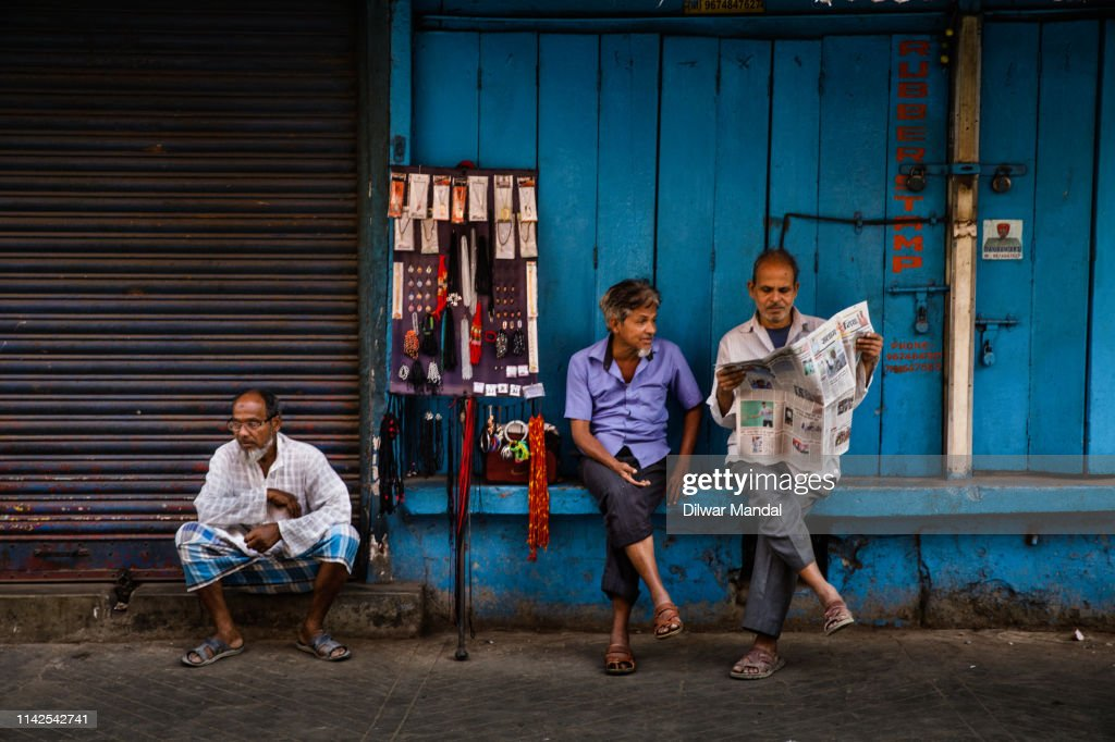 Reading Newspaper At Roadside : Stock Photo