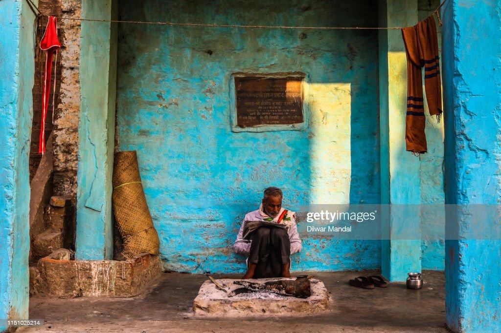 Reading Newspaper In Varanasi : Stock Photo