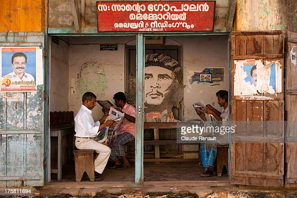 CONTENT] Reading newspapers in a local of a political party in Fort Cochin Kerala