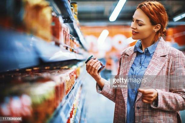 reading nutrition label on the package at supermarket. - ready to eat stock pictures, royalty-free photos & images
