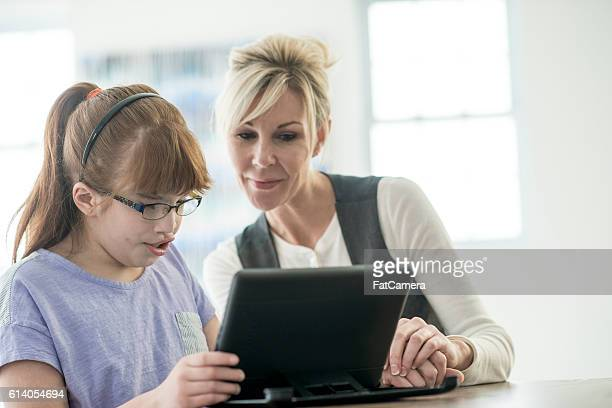 reading on a digital tablet - visual impairment stock pictures, royalty-free photos & images