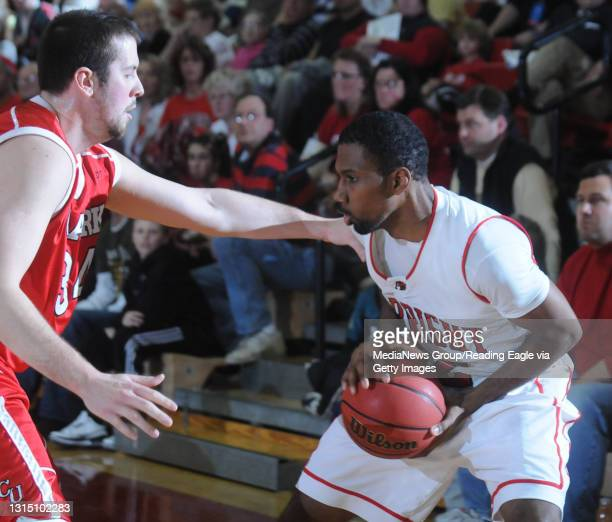 Reading, PA Albright's Andre Murphy and Clark's Jack Minister . College Men's Basketball, the Albright College Lions versus the Clark University...
