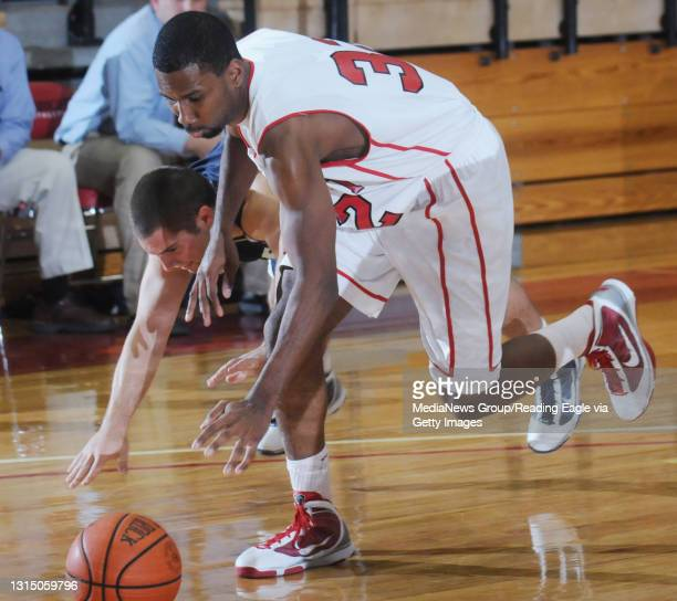 Reading, PA Albright's Andre Murphy reaches for a loose ball. College Men's Basketball, the Albright College Lions versus the Messiah College Falcons...
