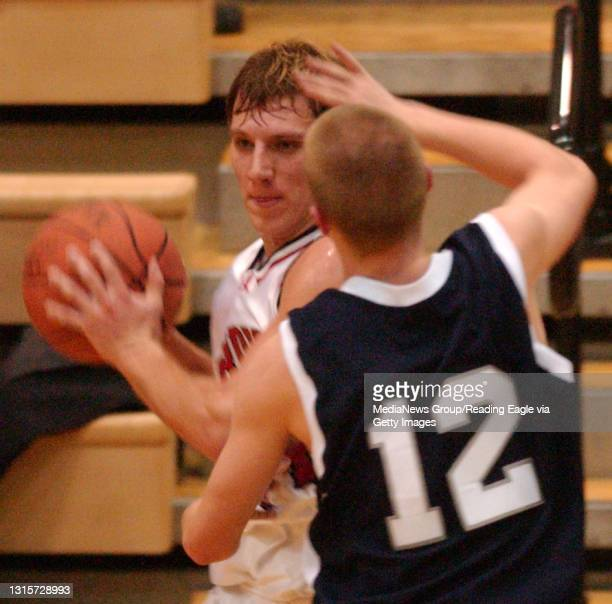 Reading, PA - Albright's Tom Murphy, #44, tries to move around Moravian's Ryan Miller, #12.Moravian Albright Men's basketball Wed night. Photo by Ben...