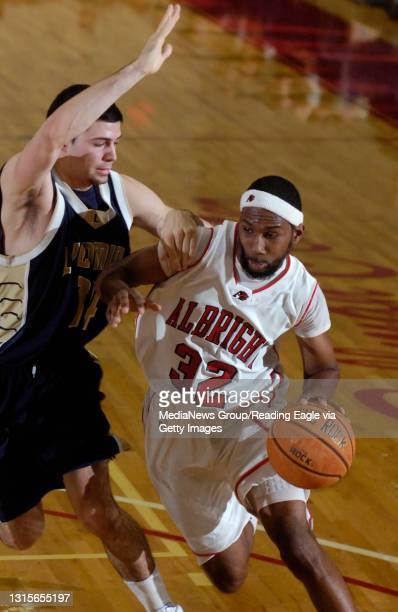 Reading, PAAlbright's Andre Murphy tries to move around Lycoming's Sebastian Sabella .College men's Basketball Lycoming College Warriors versus the...
