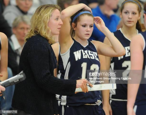Reading, PAConrad Weiser head coach Adelle Schade with Conrad Weiser's Kennedy Lutz .Girls basketball, the Conrad Weiser Scouts vs the Oley Valley...