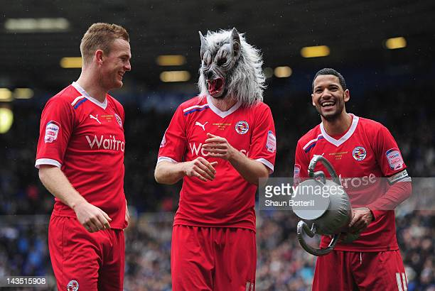 Reading players Alex Pearce Kaspars Gorkss and Jobi McAnuff celebrate with their fans after the npower Championship match between Birmingham City and...