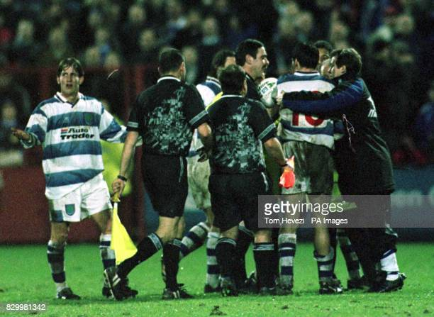 Reading players and officials surround referee George Cain and officials AC Harvey and BL Baker after Craig Hignett's controversial winning goal for...