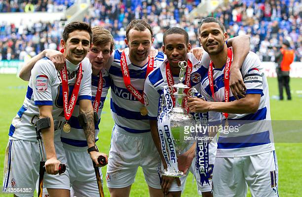 Reading players Jem Karacan Jay Tabb Noel Hunt Shaun Cummings and Jobi McAnuff celebrate with the npower Championship Trophy during the Reading...