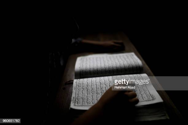 reading quran - holy quran stock pictures, royalty-free photos & images