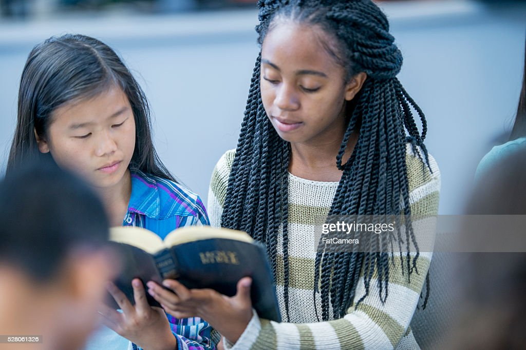 Reading the Bible Together : Stock Photo