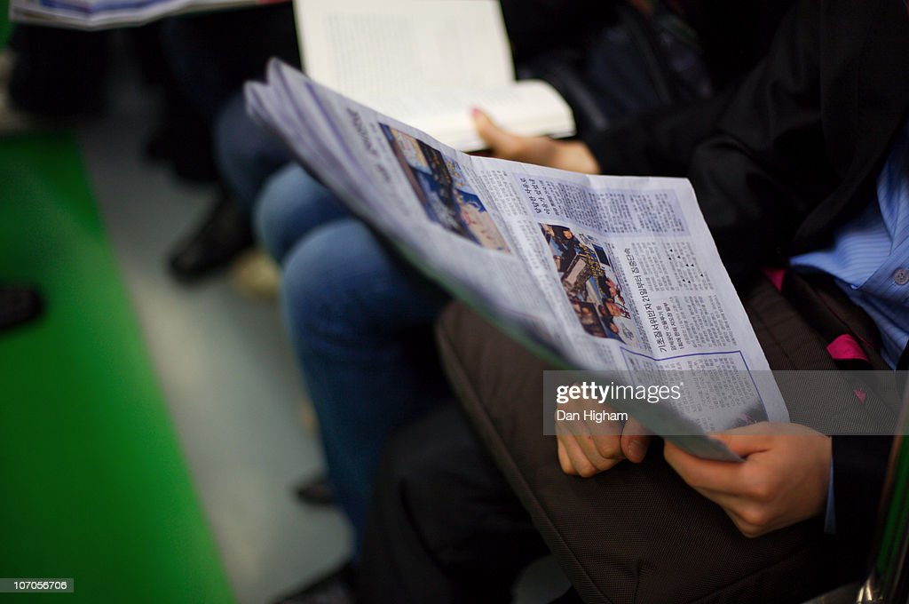 Reading the daily news : Stock Photo