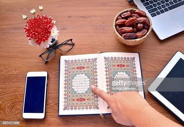 reading the holy quran (islamic book) in ramadan night. - muhammad prophet stock photos and pictures