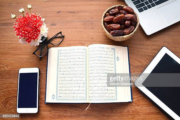 reading the holy quran (islamic book) in ramadan night. - namaz stock pictures, royalty-free photos & images