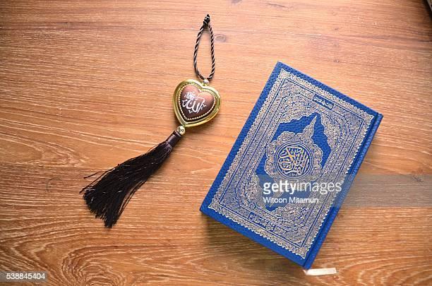 reading the holy quran(islamic book) in ramadan night. - salah islamic prayer stock pictures, royalty-free photos & images