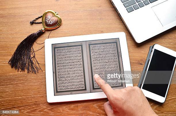 reading the holy quran in ramadan night. - muhammad prophet stock photos and pictures
