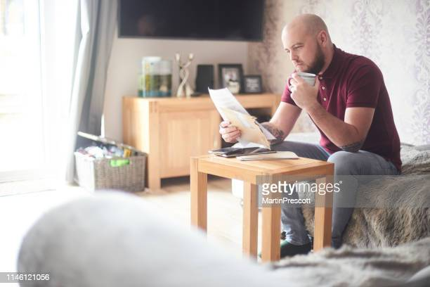 reading the latest letter - financial bill stock pictures, royalty-free photos & images