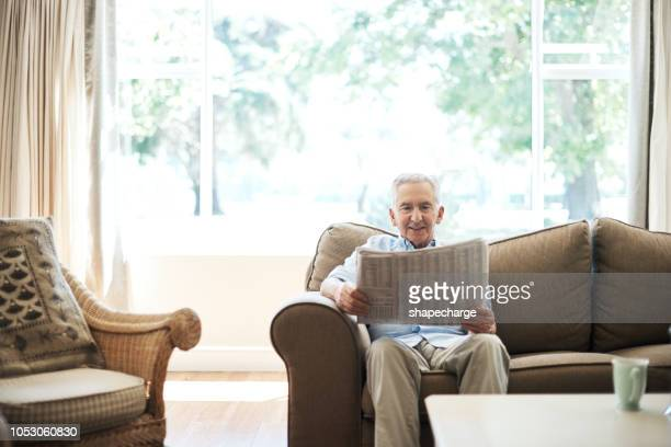 reading the morning paper - one senior man only stock pictures, royalty-free photos & images