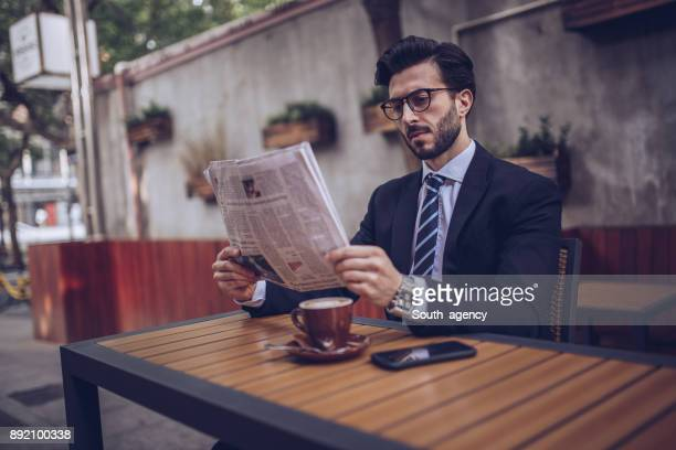 Reading the news in cafe