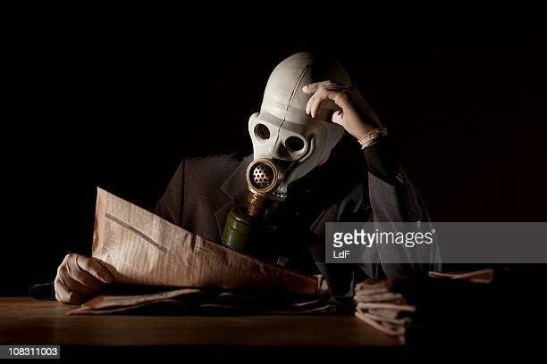Reading the news with a gas mask