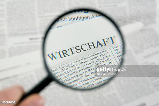 reading the newspaper with a magnifying glass - western script stock pictures, royalty-free photos & images