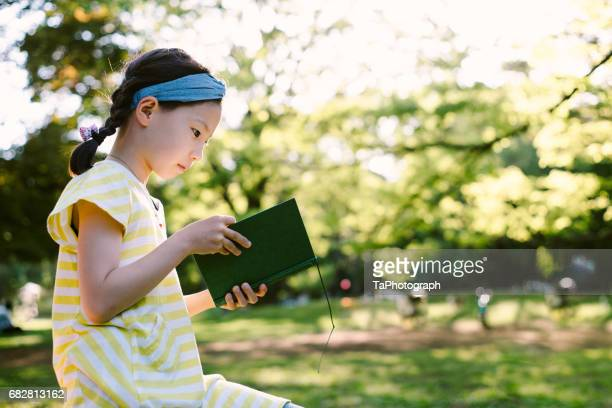 reading the story - storyteller stock pictures, royalty-free photos & images
