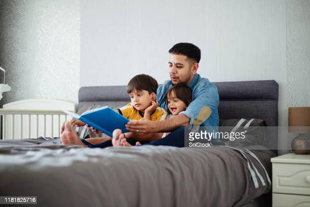 reading to his son's - preschool child stock pictures, royalty-free photos & images