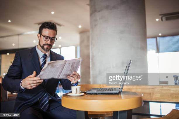 reading today news in cafe - picture magazine stock photos and pictures