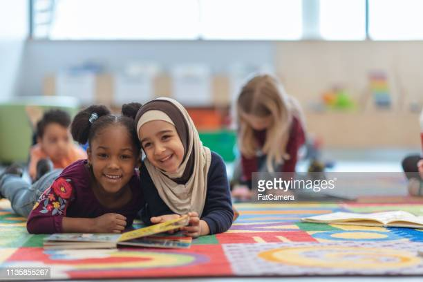 reading together - preschool age stock pictures, royalty-free photos & images