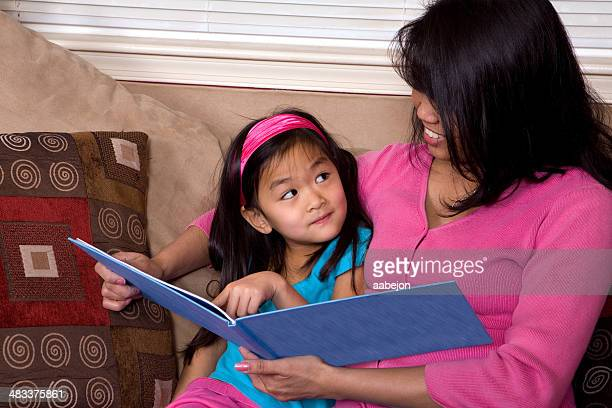 reading together - philippines family stock pictures, royalty-free photos & images