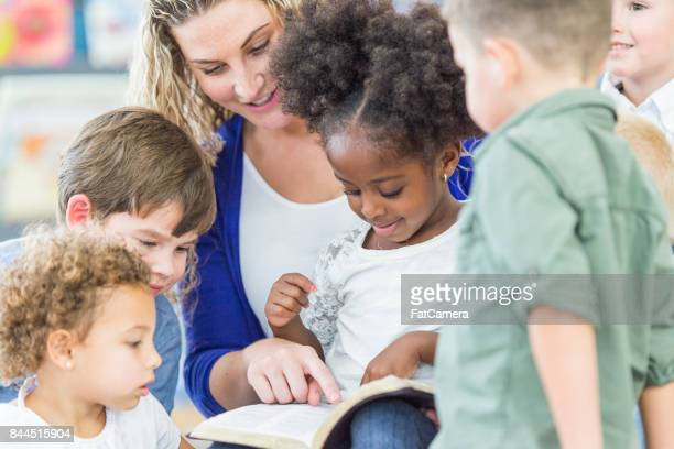 reading together - christianity stock pictures, royalty-free photos & images