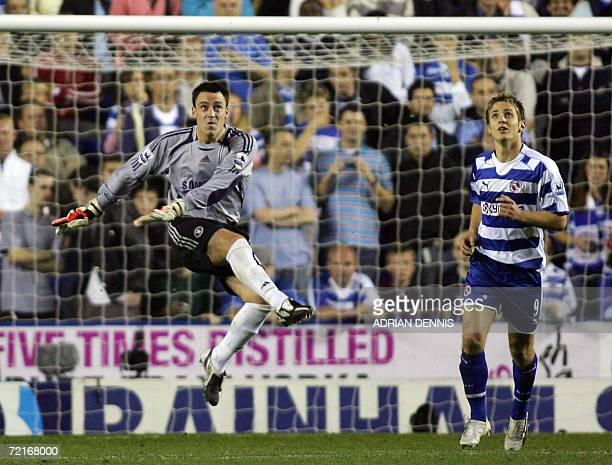 Reading, UNITED KINGDOM: Chelsea's John Terry clears the ball, taking over as goalkeeper after both Chelsea keepers were injured during the...