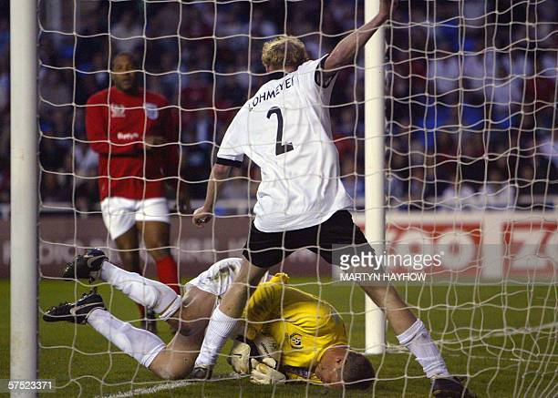 Germany's Peter Lohmeyer and England keeper Chris Woods in what could have been Germany's third goal as they take part in the charity England v...
