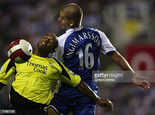 Reading's Ivar Ingimarsson competes for the ball against Manchester City's Trevor Sinclair during the Premiership football match at the Madejski...
