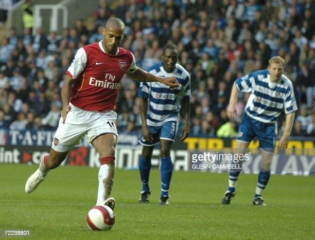 Reading, UNITED KINGDOM: Thierry Henry of Arsenal scorea from the penalty spot, during the 4-0 win for Arsenal in English Premiership match against...