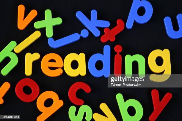 reading written with toy blocks