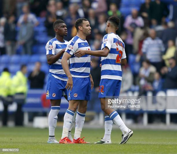 Reading's Aaron Tshibola Reading's Hal RobsonKanu and Reading's Nick Blackman celebrate after the final whistle