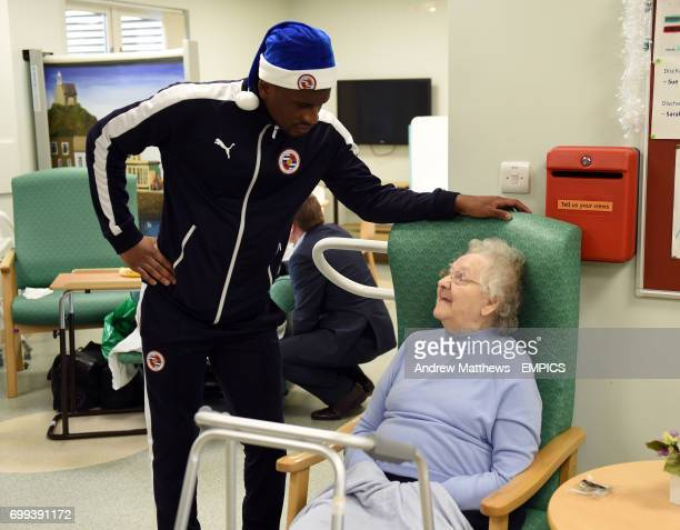 Reading's Aaron Tshibola talks to a patient during a visit to The Royal Berkshire Hospital in Reading