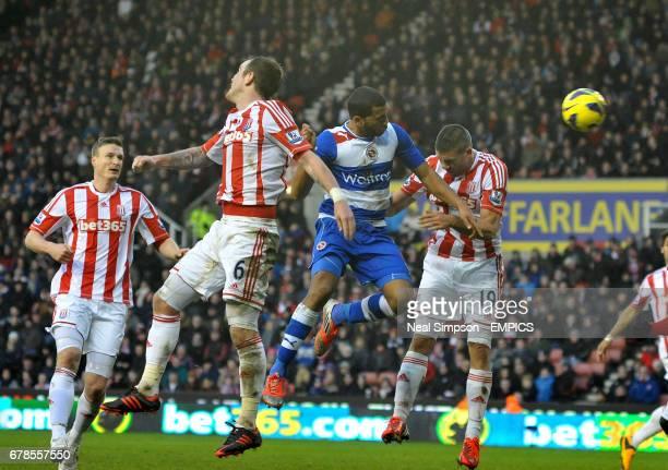 Reading's Adrian Mariappa gets between Stoke City's Glenn Whelan and Jon Walters to score