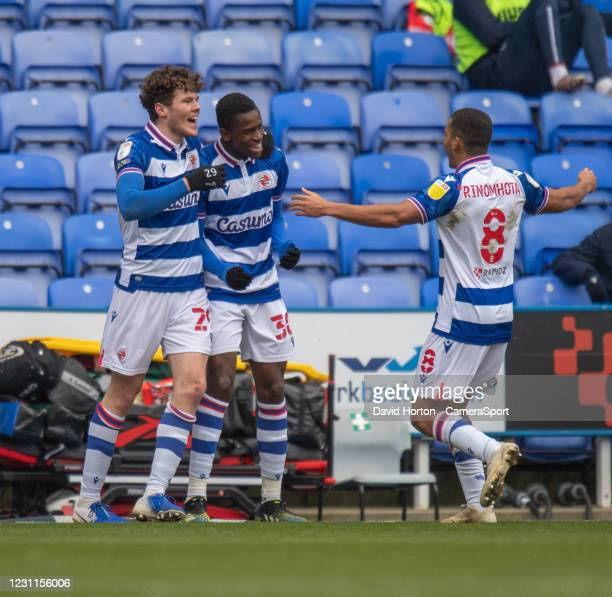 Reading's Alfa Semedo Esteves celebrates scoring his side's first goal with team-mate during the Sky Bet Championship match between Reading and...