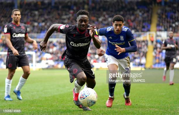 Reading's Andy Yiadom battle for the ball with Birmingham City's Jude Bellingham during Birmingham City's and Reading's Birmingham City v Reading Sky...