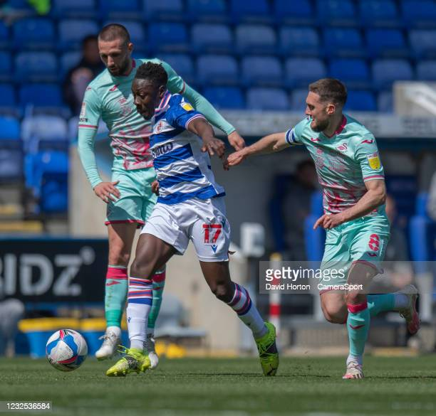 Reading's Andy Yiadom battles with Swansea City's Conor Hourihane and Matt Grimes during the Sky Bet Championship match between Reading and Swansea...
