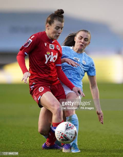 Reading's Angharad James and Manchester City's Georgia Stanway battle for the ball during the FA Women's Super League match at the Academy Stadium,...