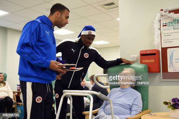Reading's Anton Ferdinand and Aaron Tshibola talk to a patient during a visit to The Royal Berkshire Hospital in Reading