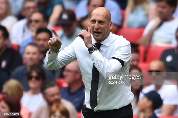 Reading's Dutch manager Jaap Stam gestures on the touchline during the English Championship playoff final football match between Huddersfield Town...