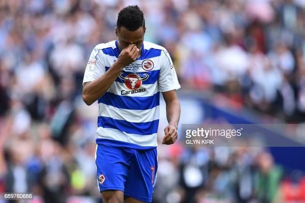 Reading's English defender Jordan Obita reacts after missing his penalty in the shootout during the English Championship playoff final football match...